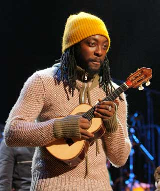 Will.I.Am holding a uke